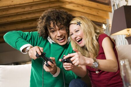 videogame: multiethnic couple having fun with a new videogame