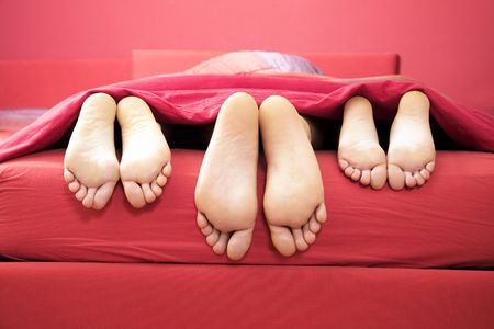 girl lying: domestic life: threesome sharing the same bed
