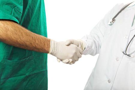 healthcare and medicine: nurse and surgeon hand shaking