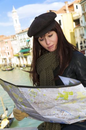 vacationer: tourist attractions: woman reading a tourist map in Venice Stock Photo