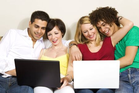 domestic life: domestic life: two couples using laptops Stock Photo