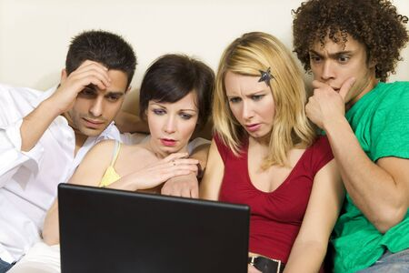 domestic life: group of friends having problems with computers Stock Photo