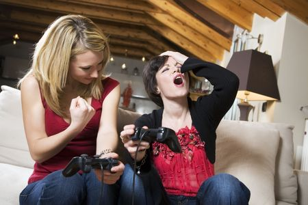 girls having fun with a new videogame photo