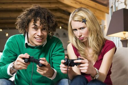 girl feeling awkward at playing videogames Stock Photo - 2697535