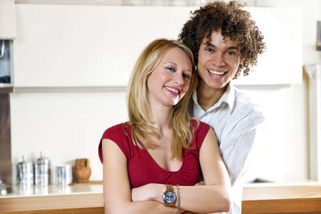 domestic life: happy interracial couple hugging Stock Photo - 2726570