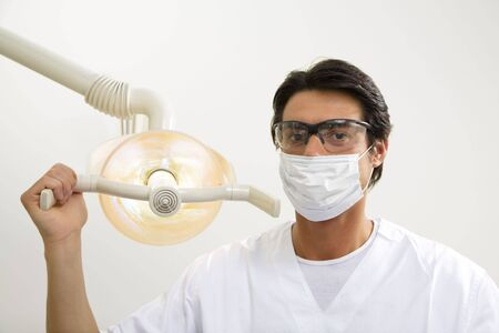 dentist turning on examination light photo