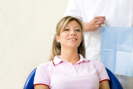 dentist and his patient in examination room. Copy space Stock Photo - 2783455