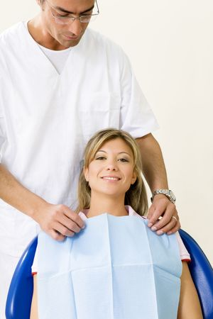dentist and his patient in examination room photo