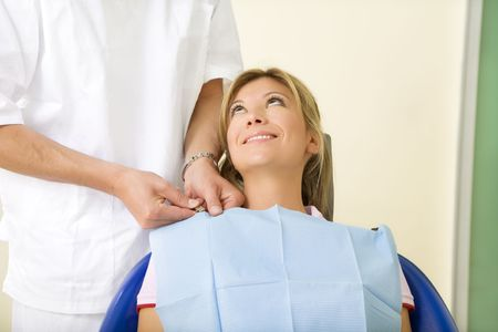 dentist and his patient in examination room. Copy space photo