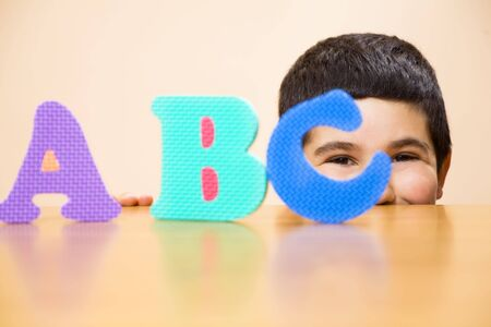 abc's: child learning the ABCs. The focus i son the his eyes