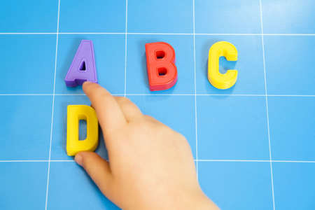 abc's: child learning the ABCs. The focus is on the letter B Stock Photo