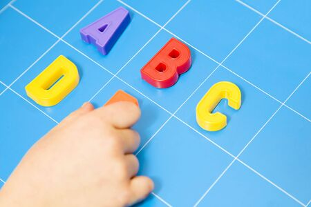 child learning the ABCs. The focus is on the letter B Stock Photo