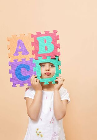abc's: child learning the ABCs. The focus is on her eyes