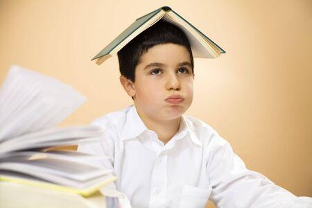 disinterested: little boy getting bored of doing homework