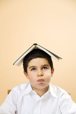 snort: little boy getting bored of doing homeworks