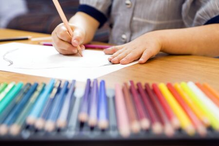 little girl playing with colors. The focus is on the hand laying on the paper Stock Photo - 2891636