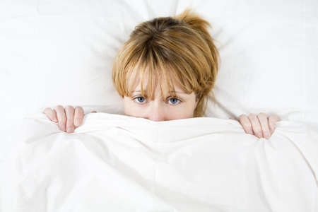 Young woman lying in bed doesn't want to wake up  Stock Photo - 2913585