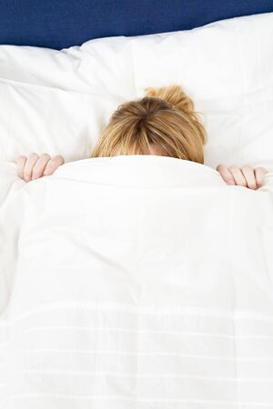 Young woman lying in bed doesn't want to wake up. Copy space Stock Photo - 2913580