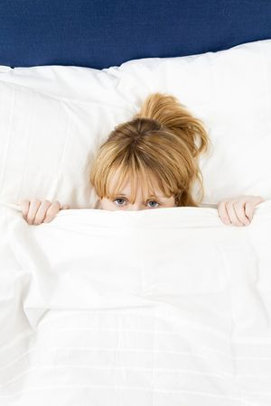 Young woman lying in bed doesn't want to wake up. Copy space Stock Photo - 2925857