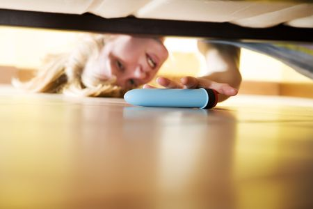 woman looking for her dildo under the bed Stock Photo - 2956481