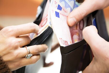 young couple counting money in their wallet Stock Photo - 2986123
