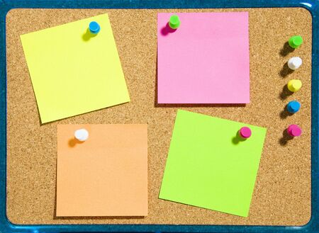 bulletin board and multi colored stickies attached with push pins. Copy space Stock Photo - 3004834