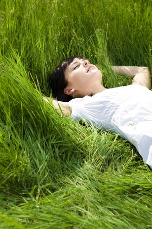 girl lying: beautiful girl lying down of grass. Copy space