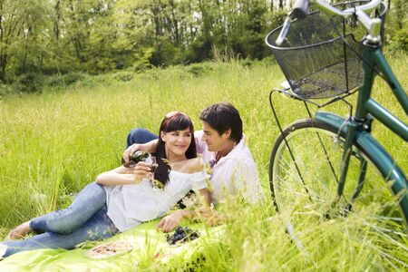 couple having a picnic in a park, smiling photo