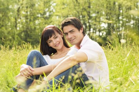 Couple lying in grass, smiling and hugging Stock Photo - 3070897