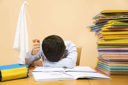 little boy holding white flag, exhausted by doing homeworks Stock Photo - 3124804