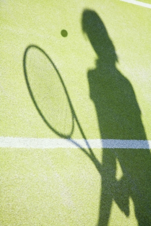 shadow on tennis court of woman hitting the ball Stock Photo - 3133538