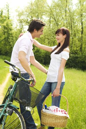 couple in park with holding picnic basket, hugging and smiling Stock Photo - 3136953