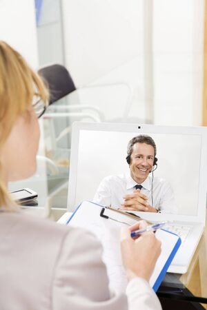 Businessman having laptop conference call with colleague. Stock Photo - 3175728