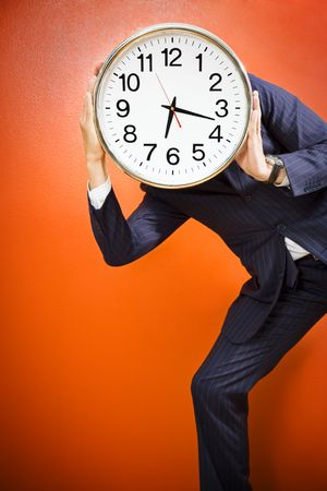Businessman with clock on head, studio shot. photo