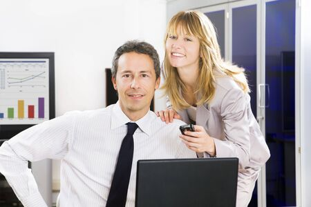 Businesspeople in office looking at camera and smiling photo