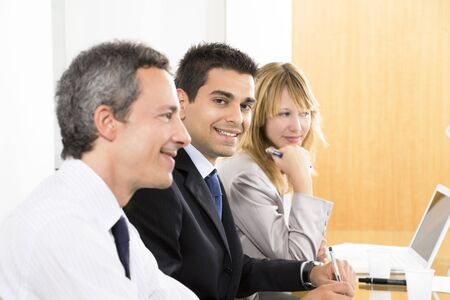 Portrait of business man among colleagues in meeting photo