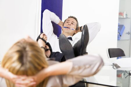 Mature businessman relaxing in office, leaning feet on desk Stock Photo - 3196739