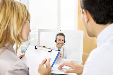 Businessman having laptop conference call with colleague. Stock Photo - 3196734