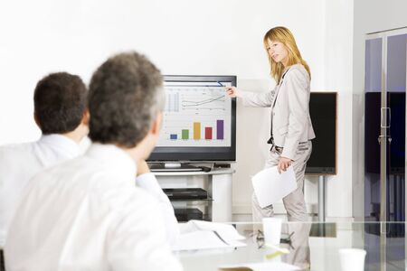 Businesspeople in office. Blond woman having a presentation photo