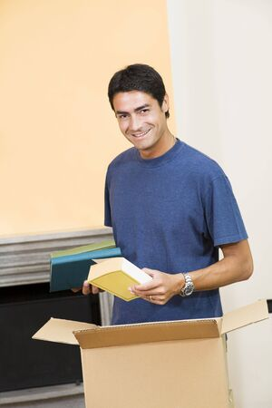 cardboard only: young man holding cardboard boxes and smiling Stock Photo