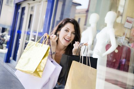 Mid adult Italian woman holding shopping bags photo
