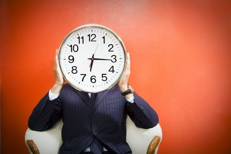 Businessman with alarm clock on head, studio shot. Stock Photo - 3423453