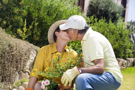 Portrait of senior Italian couple in garden photo