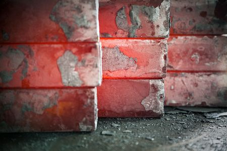 metallurgy: piles of hot iron blocks in foundry. Narrow focus on central block Stock Photo