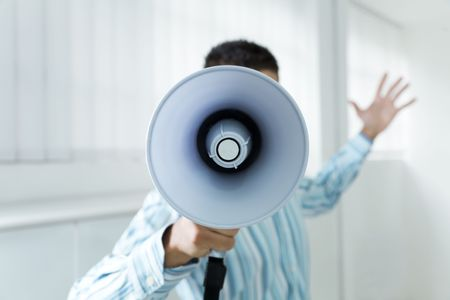 young businessman in office screaming on the megaphone Stock Photo - 3556763