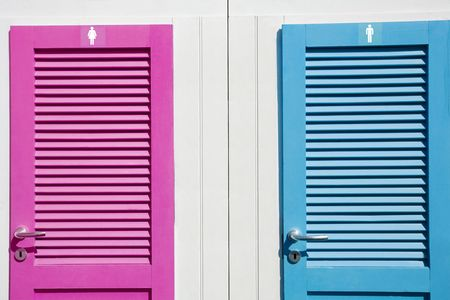 according: Colored restrooms doors. You can easily change hues according to your project Stock Photo