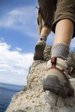 young woman reaching the top of a mountain. Stock Photo - 3568631