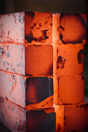 red hot iron: piles of hot iron blocks in foundry. Narrow focus on central block Stock Photo