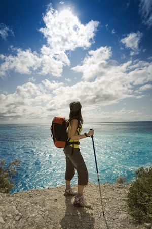 young woman hiking and looking up to the sky Stock Photo - 3589888