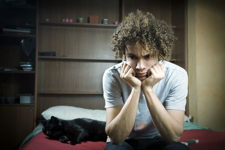 Young Brazilian teenager sad and upset in bedroom Stock Photo - 3600551